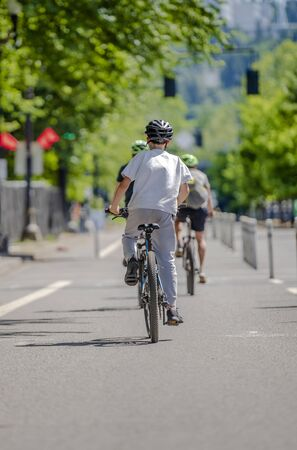 The people on the bicycles pedals a bike preferring an active healthy lifestyle using cycling and alternative environmentally friendly mode of transport in order to preserve nature environment
