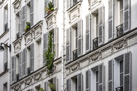 Residential houses with sculptural bas-reliefs, wooden shutters, humpbacked roofs and attic add-ons structures attract crowds of tourists to Paris with their unique charm of the French lifestyle