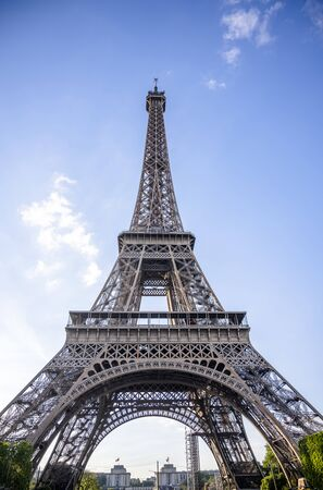 The unique iconic famous Eiffel Tower, as a symbol and main landmark of Paris and the French inventive genius in the historical past, attracts thousands of tourists with its design and uniqueness Zdjęcie Seryjne - 129624554