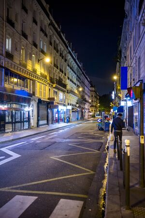 Shining lights of the night Paris city streets attract tourists with charm of combining exquisite architecture and simple residential buildings filled with tiny boutiques bakeries and street cafes