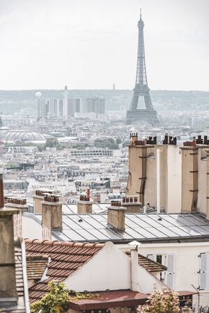 Paris cityscape overlooking the target and dream of tourists famous Eiffel Tower and the old city with iron roofs and chimneys from Montmartre hill
