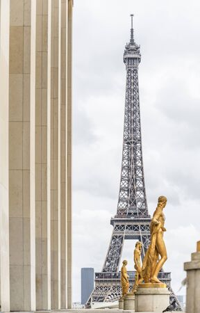The Eiffel Tower and bronze sculptures as a way of self-expression of talented people in the medium of technological and fine art, which made Paris so attractive for tourists Zdjęcie Seryjne