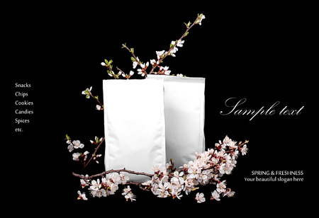 surprise box: Fresh background. White package decorated with cherry flowers isolated on black with sample text