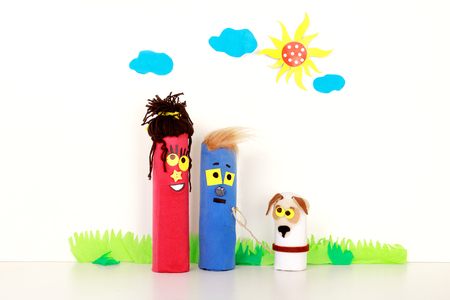 Young Happy Family and their Pet Walking Outdoors. Puppet Toys. Children theater. Handmade Stock Photo