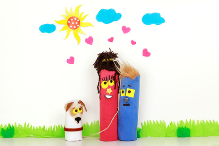 Young family in love. Happy couple together with their dog. Man and woman with pet. Funny puppet show. Social concept