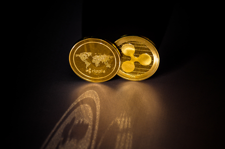 XRP Ripple coins dark background