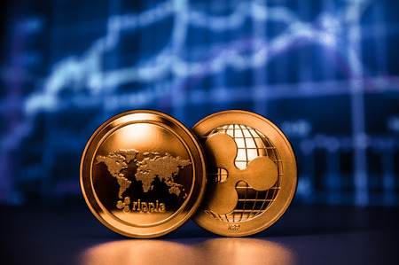 Two ripple coins with chart background