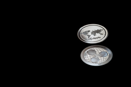 Ripple Cryptocurrency Coins on black background