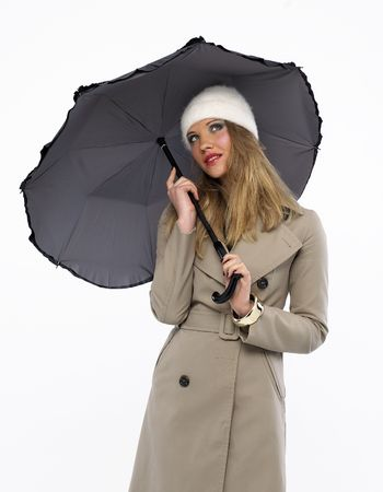 Beautiful woman whit a umbrella looking at... Stock Photo - 4171129