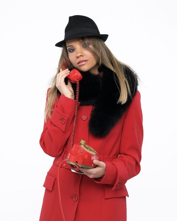 Young woman on an old red phone Stock Photo - 4171149