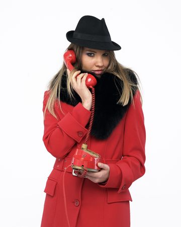 Young woman on an old red phone Stock Photo - 4171135