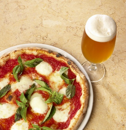 pizza whit mozzarella and glass of beer