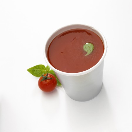 A cup of tomato soup isolated on white Stock Photo