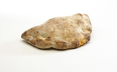 Pizza calzone isolated on white