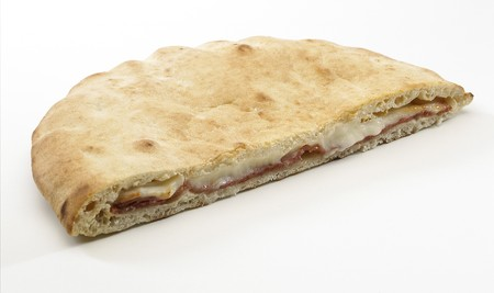 Lunchtime Panino with ham and cheese isolated on white