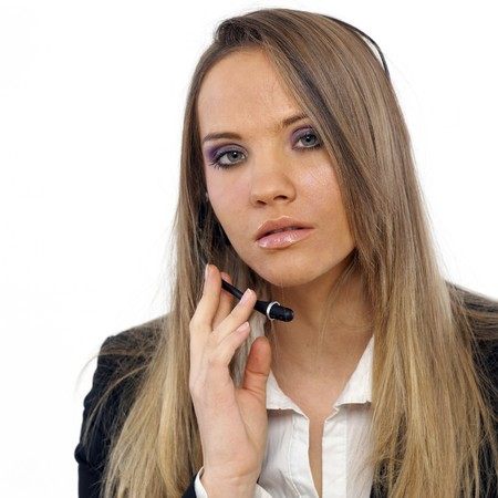An attractive business woman with a headset Stock Photo - 4434307