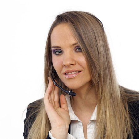 An attractive business woman with a headset Stock Photo - 4434310