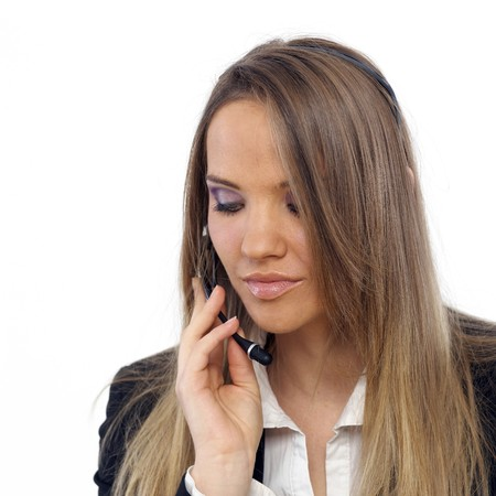 An attractive business woman with a headset Stock Photo - 4434309