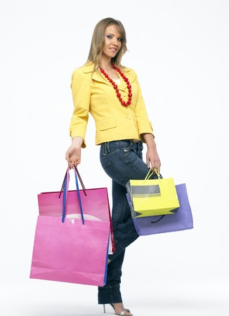 Portrait of a young happy woman with shopping bags photo