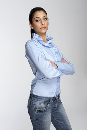 young girl with jeans isolaten on white photo