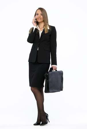 Portrait of a young attractive business woman talking on mobile phone Stock Photo - 4450869