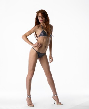 dieta: Pretty model wearing bikini on white isolated background