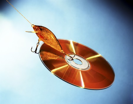 digitally generated: Cd and lure isolated on a blue background