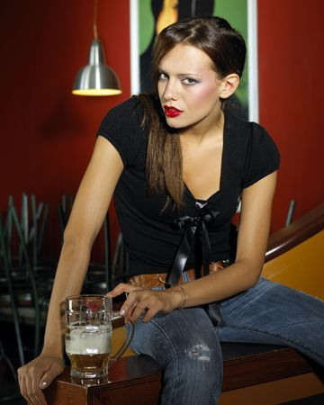 Portrait of attractive young woman with beer