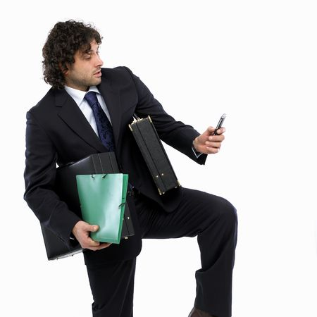 busy man with briefcase and mobilephone photo