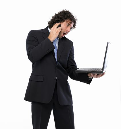 masculin: businessman with laptop and mobile phone Stock Photo