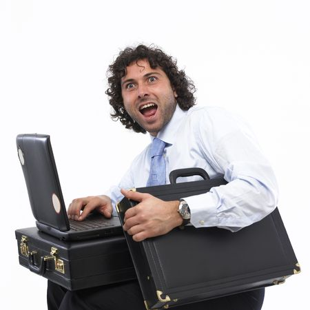masculin: happy businessman with laptop and briefcase Stock Photo