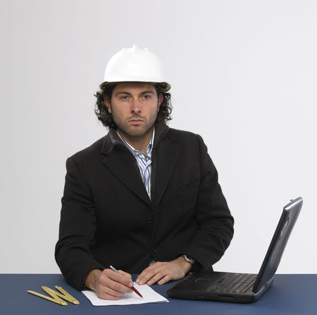 Young architect at work photo