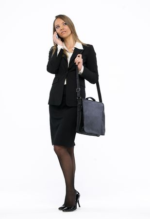 Portrait of a young attractive business woman talking on mobile phone Stock Photo - 4731480