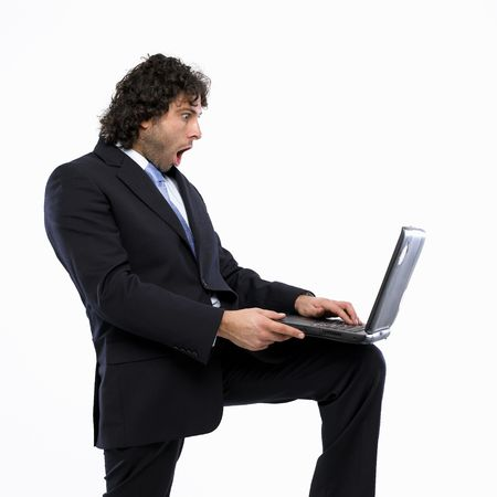 masculin: businessman with laptop isolated on white