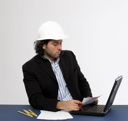 Young architect at work with laptop Stock Photo - 5036615