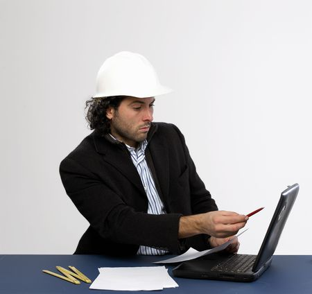 Young architect at work with laptop photo