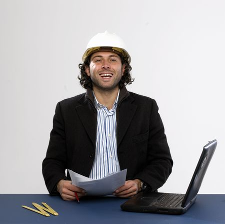 Young architect at work with laptop Stock Photo - 5036616