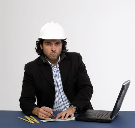 Young architect at work Writing a check Stock Photo - 5036614