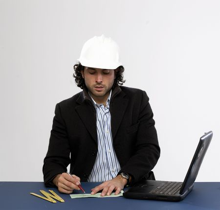 Young architect at work Writing a check photo