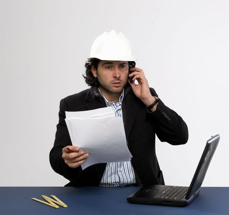 Young architect at work with laptop isolated photo