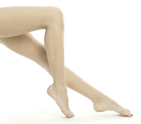 Smooth female legs on a white background