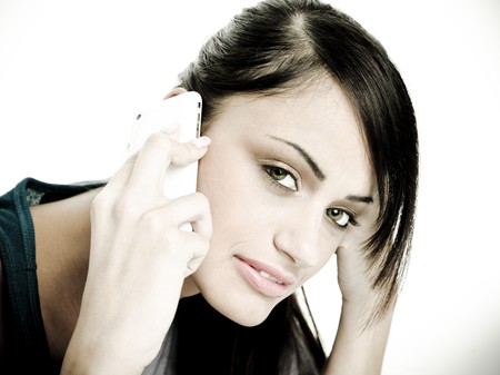Beautiful woman on phone with a very confident, freindly smile. photo
