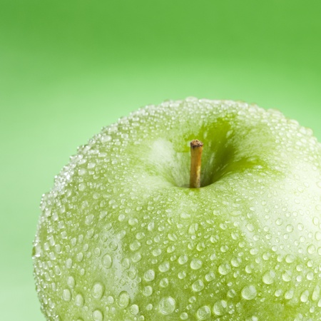 Tasty ripe green apple isolated on a green background Stock Photo