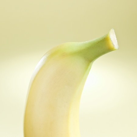 Tasty ripe banana isolated on a yellow background