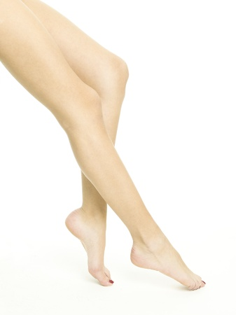 Smooth female legs on a white background photo
