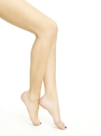 Smooth female legs on a white background Stock Photo - 9529395