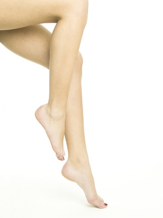 Smooth female legs on a white background Stock Photo - 9529394