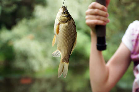 girl fishing holding a fishing rod