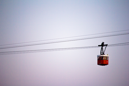 Red cabin of cableway stands out on Barcelonas port