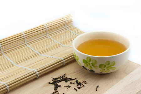 tea crop: Tea in a cup on wood with isolate background